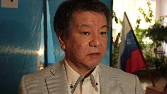 Мицухиро Кимура на избирательном участке