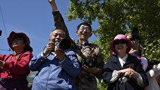 Китайские туристы на Параде Победы в Севастополе