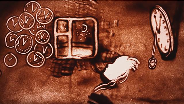 Скриншот из песочной анимации Ксении Смоновой, посвященной Виктору Цою