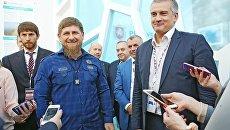 Глава Чеченской Республики Рамзан Кадыров (второй слева) и глава Республики Крым Сергей Аксенов (справа) на Международном инвестиционном форуме Сочи-2016