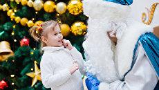 Дед Мороз с ребенком