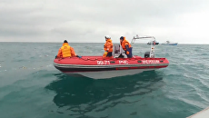 Поиск обломков и осмотр места крушения - спасатели продолжают операцию по Ту-154