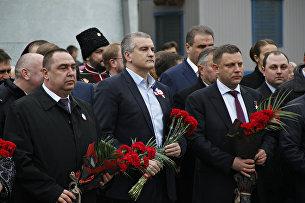 Сергей Аксенов, Игорь Плотницкий и Александр Захарченко на торжественном митинге, посвященном третьей годовщине Общекрымского референдума