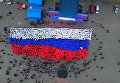 """Севастопольцы развернули """"живой"""" флаг РФ в честь третьей годовщины референдума"""