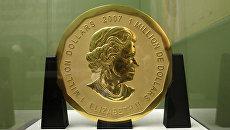 Стокилограммовая золотая монета номинальной стоимостью в 1 млн долл в Музее Боде