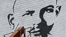 Граффити-портрет писателя журналиста Олеся Бузины
