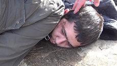 Сотрудники ФСБ задерживают одного из организаторов террористического акта в метро Санкт-Петербурга Аброна Азимова