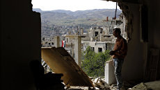 Последствия авиаударов в сирийском городе Забадани. Архивное фото