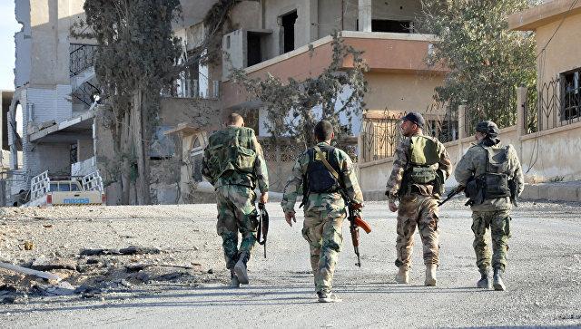 Сирийские солдаты в Хомсе. Архивное фото