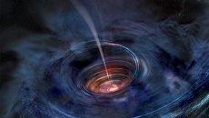 Так художник представил себе разрыв звезды на части черной дырой в галактике Swift J1644+57