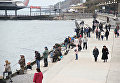 Рыбаки на набережной Ялты