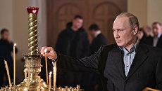 Президент РФ Владимир Путин посетил Рождественское богослужение