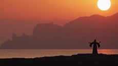 Скриншот видеоклипа крымско-татарского ансамбля Къырым на песню Пенджереси