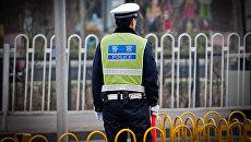 Сотрудник полиции в Китае. Архивное фото