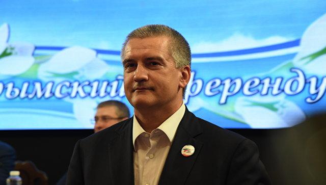 Глава Республики Крым Сергей Аксенов на торжественном собрании по случаю четвертой годовщины воссоединения полуострова с Россией